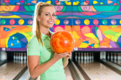 Young woman bowling having fun Royalty Free Stock Photography