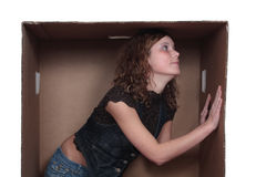 Young woman in box. Young woman in heavy-weight paper box Stock Images