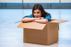 The young woman with box in moving house concept Royalty Free Stock Photos