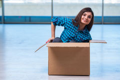 The young woman with box in moving house concept Stock Photo
