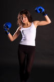 Young woman boxer. Young woman boxer poses with boxing gloves Stock Photo