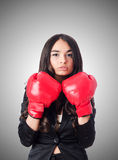 Young woman with boxing glove Royalty Free Stock Photo