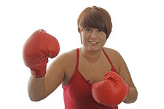 Young woman with boxing gloves Royalty Free Stock Photos