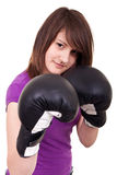 Young woman with boxing gloves Stock Photo