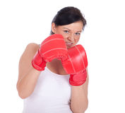Young woman in boxing gloves Royalty Free Stock Photography