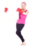 Young woman in boxing gloves with blank card Royalty Free Stock Photography
