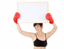 Young woman in boxing gloves with blank sign Stock Images