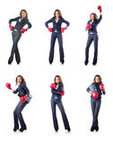 The young woman with boxing gloves isolated on white Stock Photo