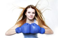 Young woman in boxing gloves over white Stock Images