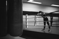 Young woman in boxing gloves on a ring Stock Photo