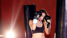 Young woman boxing with punching bags. Slow motion. stock video footage