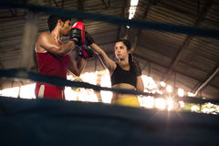 Young woman at boxing and self defense course. Young women exercising with trainer at boxe and self defense lesson. Copy space Stock Photo