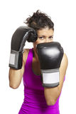Young woman boxing in sports outfit Stock Photo