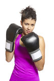 Young woman boxing in sports outfit Stock Image