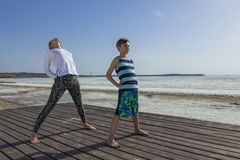 Young woman and boy doing back bending Stock Photo
