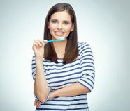 Young woman with brace brushing teeth. Isolated portrait Stock Photo