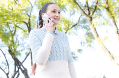 Young woman with braces talking on phone Stock Photography