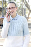 Young woman with braces talking on phone Royalty Free Stock Photos