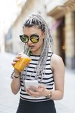 Beautiful woman drinking fruit shake. Stock Photos