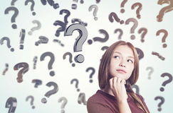 Young woman with braided hair and floating question marks in sun Stock Photography