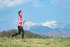 Young woman with braids in her hair during a sport walk in the mountains.  stock photo