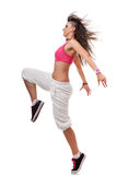 Young woman breakdancer in leaping pose. Side view of a young breakdancer in leaping pose, isolated on white stock image