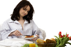 Young woman with breakfast in bed Stock Photo