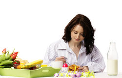 Young woman at breakfast eating corn flakes Stock Photo