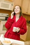 Young woman at breakfast time Stock Image