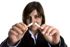 Young woman breaking cigar - anti-tobaco concept Royalty Free Stock Photo
