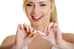 Young woman breaking cigarette Stock Photos
