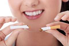 Young woman breaking cigarette Royalty Free Stock Photos