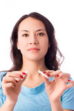 Young woman breaking a cigarette Royalty Free Stock Photo