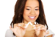 Young woman breaking a cigarette. Stock Photography