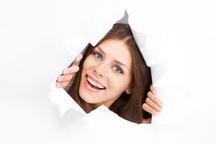 Young woman breaking through a paper sheet Royalty Free Stock Image