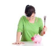 Young woman breaking a piggy bank Royalty Free Stock Photo
