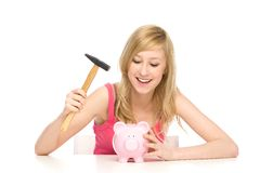 Young woman breaking piggy bank Royalty Free Stock Photography