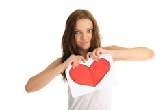 Young woman breaks the painted heart Royalty Free Stock Images