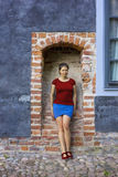 Young woman in a brick arc Royalty Free Stock Images