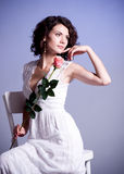 Young woman in bridal dress with rose Stock Images