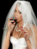 Young Woman Bride Drinking and Smoking Royalty Free Stock Images