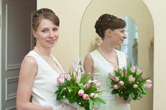 Young woman a bride near mirror Stock Image