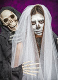 Young woman a bride in a veil day of the dead mask skull face art. And skeleton. Halloween face art Royalty Free Stock Photos
