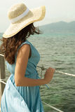 Young woman on bridge. Summer time. Royalty Free Stock Image