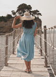 Young woman on bridge. Summer time. Stock Images