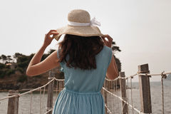 Young woman on bridge. Summer time. Royalty Free Stock Photos