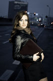 Young woman with briefcase Stock Photos