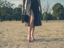 Young woman with briefcase in park Royalty Free Stock Photography