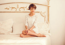 Young woman in a bright bedroom Stock Photos