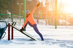 A young woman running winter stock images